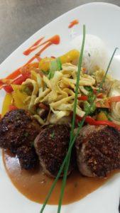 Thai spiced roasted Porktenderloin medallions with Wok vegetables & Thai Curry sauce